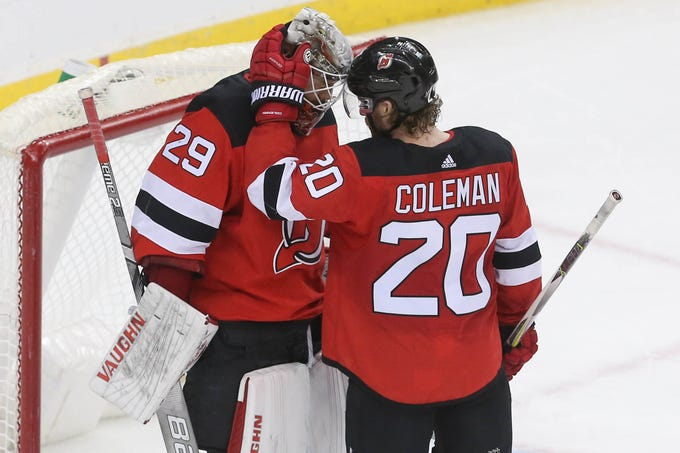 Jan 12, 2019; Newark, NJ, USA; New Jersey Devils center Blake Coleman (20) and goaltender Mackenzie Blackwood (29) celebrate their 3-2 win over the Philadelphia Flyers at Prudential Center.
