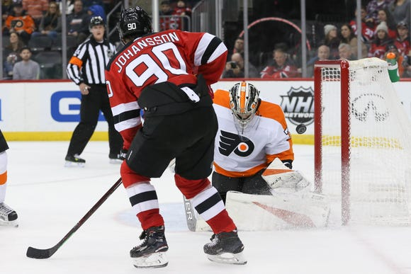 Jan 12, 2019; Newark, NJ, USA; Philadelphia Flyers goaltender Carter Hart (79) makes a save on New Jersey Devils left wing Marcus Johansson (90) during the second period at Prudential Center.
