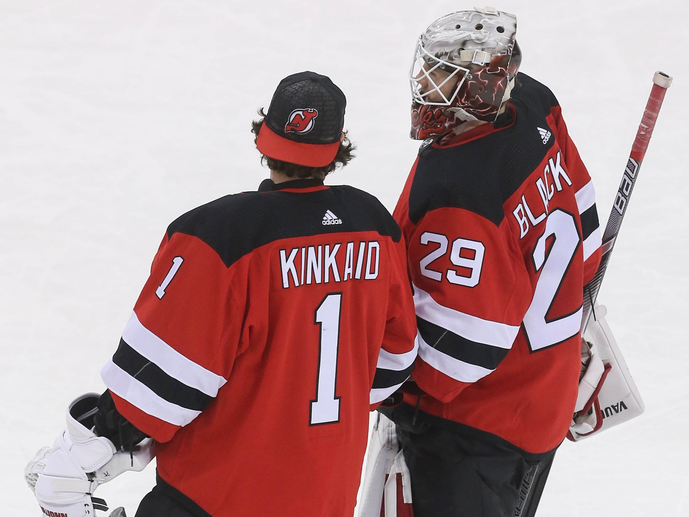 Jan 12, 2019; Newark, NJ, USA; New Jersey Devils goaltender Mackenzie Blackwood (29) and goaltender Keith Kinkaid (1) celebrate their 3-2 win over the Philadelphia Flyers at Prudential Center.