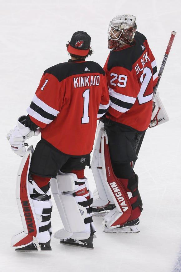 Jan 12, 2019; Newark, NJ, USA; New Jersey Devils goaltender Mackenzie Blackwood (29) and goaltender Keith Kinkaid (1) celebrate their 3-2 win over the Philadelphia Flyers at Prudential Center.
