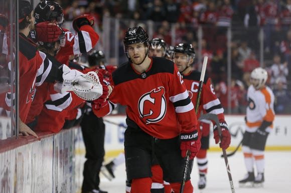 Jan 12, 2019; Newark, NJ, USA; New Jersey Devils defenseman Damon Severson (28) celebrates his goal during the first period of their game against the Philadelphia Flyers at Prudential Center.