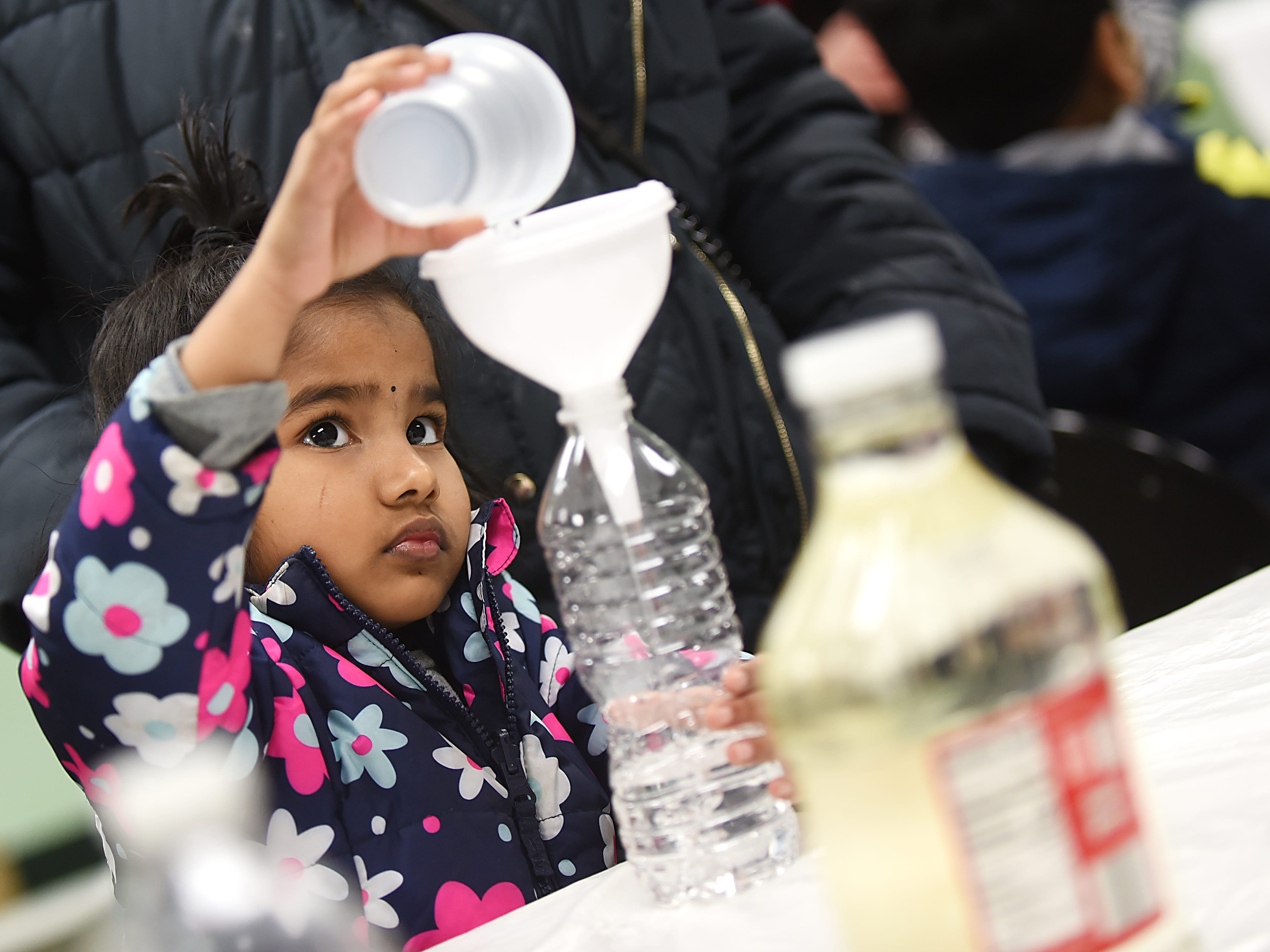 Kausalya Mahalingam, 4 makes a snowstorm in a bottle as part of the STEM Saturday series at East Rutherford Memorial Library on Saturday January 12, 2019.