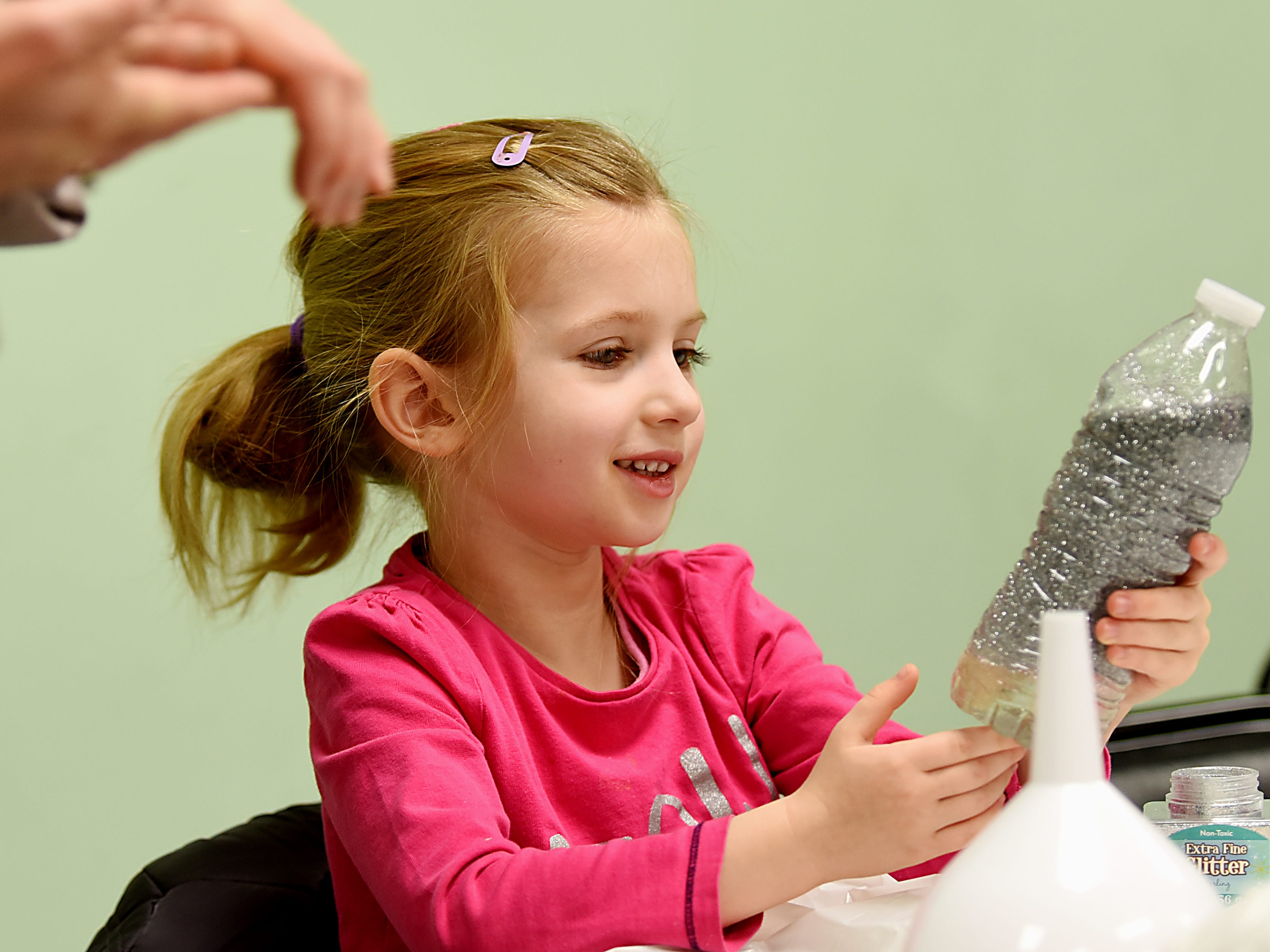 Olivia Mazur, 5 smiles as she looks at her snowstorm in a bottle. This is part of the STEM Saturday series at East Rutherford Memorial Library on Saturday January 12, 2019.