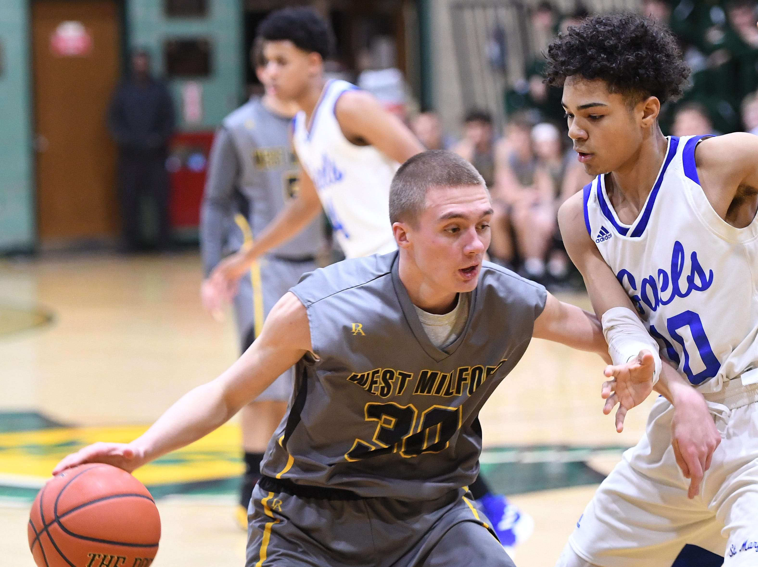 Public vs. Private Basketball Showcase at St. Joseph High School in Montvale on Saturday, January 12, 2019. West Milford vs. St. Mary. WM #30 Josiah Basket tries to get past SM #10 Nick Boyd.