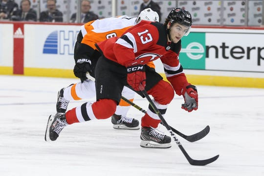 Jan 12, 2019; Newark, NJ, USA; New Jersey Devils center Nico Hischier (13) goes on the offensive during the second period of their game against the Philadelphia Flyers at Prudential Center.