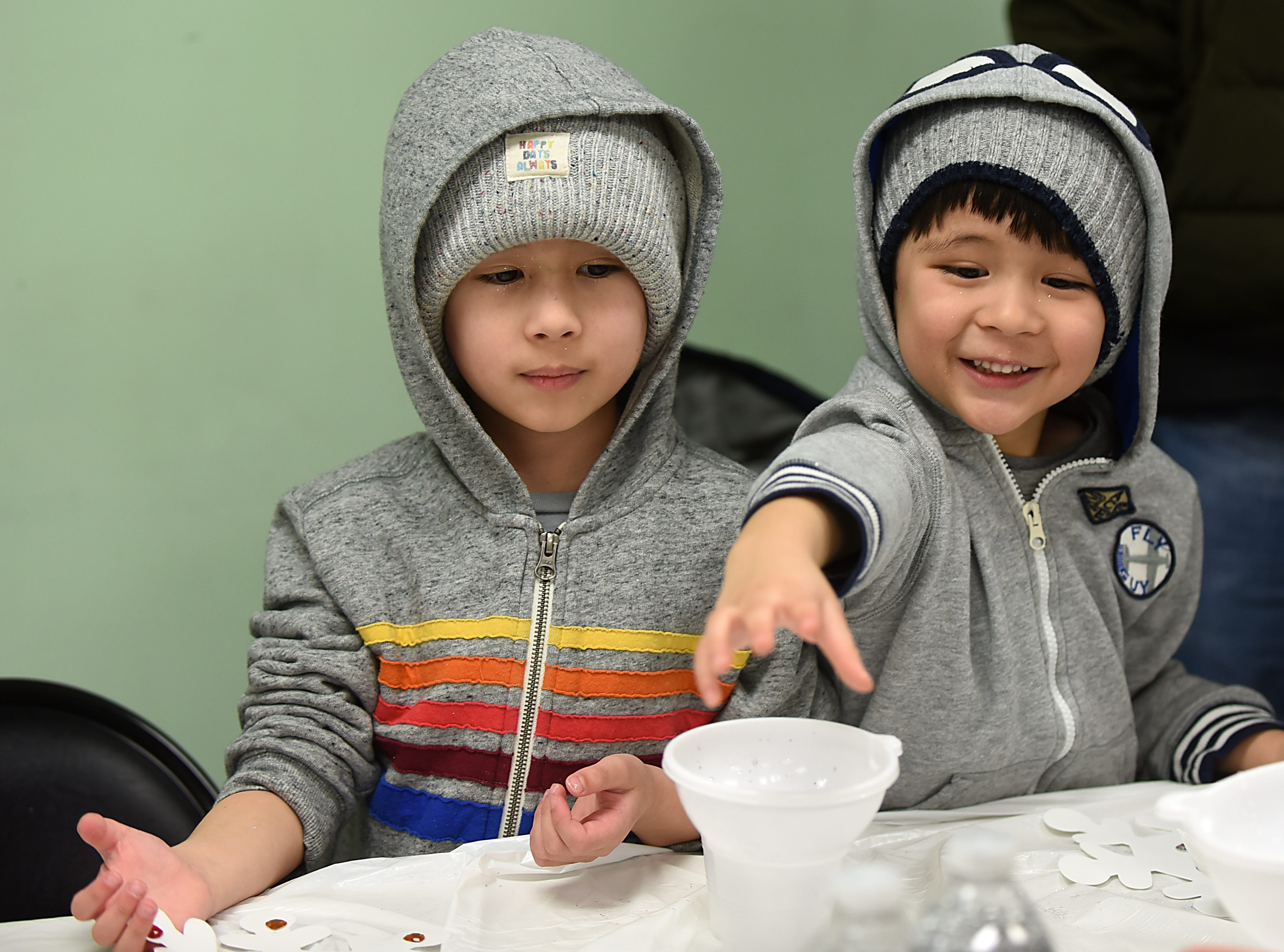 Children make a snowstorm in a bottle as part of the STEM Saturday series at East Rutherford Memorial Library on Saturday January 12, 2019. Alexander Green, 4 and Anthony Green, 6  make their snowstorms.