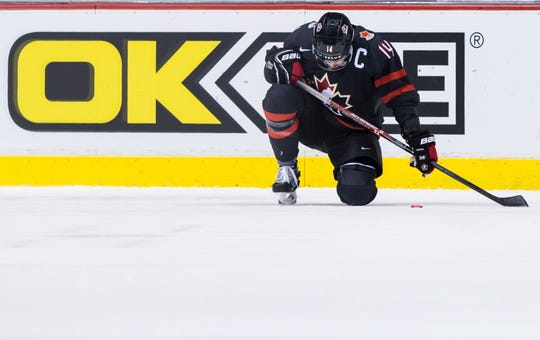 Canada's Maxime Comtois kneels on the ice after losing to Finland during overtime of a world junior hockey championships game in Vancouver, British Columbia, Wednesday, Jan. 2, 2019.