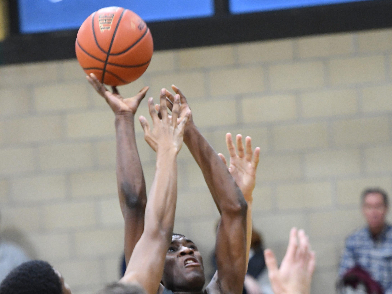 Public vs. Private Basketball Showcase at St. Joseph High School in Montvale on Saturday, January 12, 2019. E #12 Daizon Pauldo takes a shot. E #1 Anthony Dunbar drives to the basket.