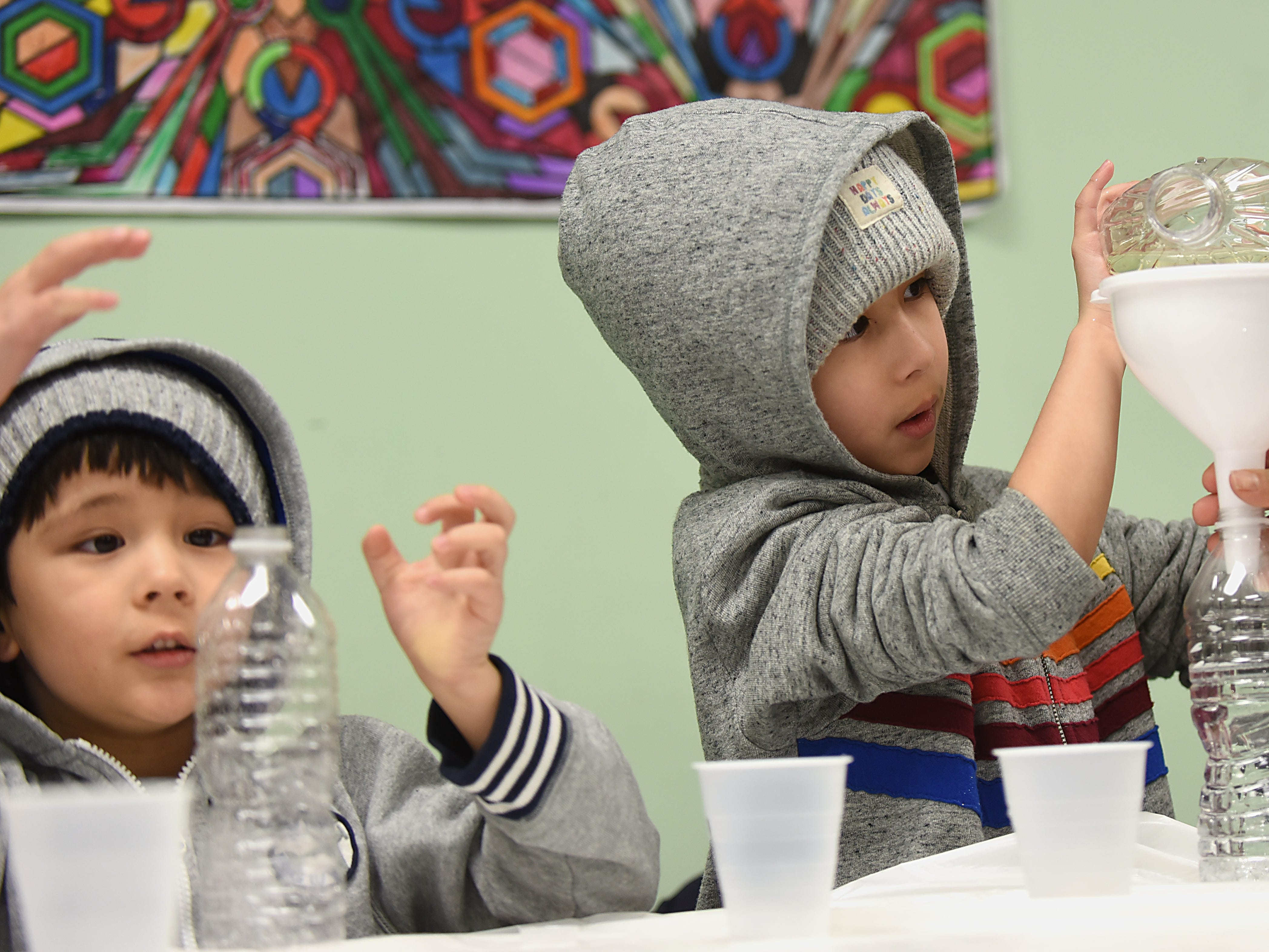 Children make a snowstorm in a bottle as part of the STEM Saturday series at East Rutherford Memorial Library on Saturday January 12, 2019. Alexander Green, 4 and Anthony Green, 6 concentrate as they make their snowstorms.