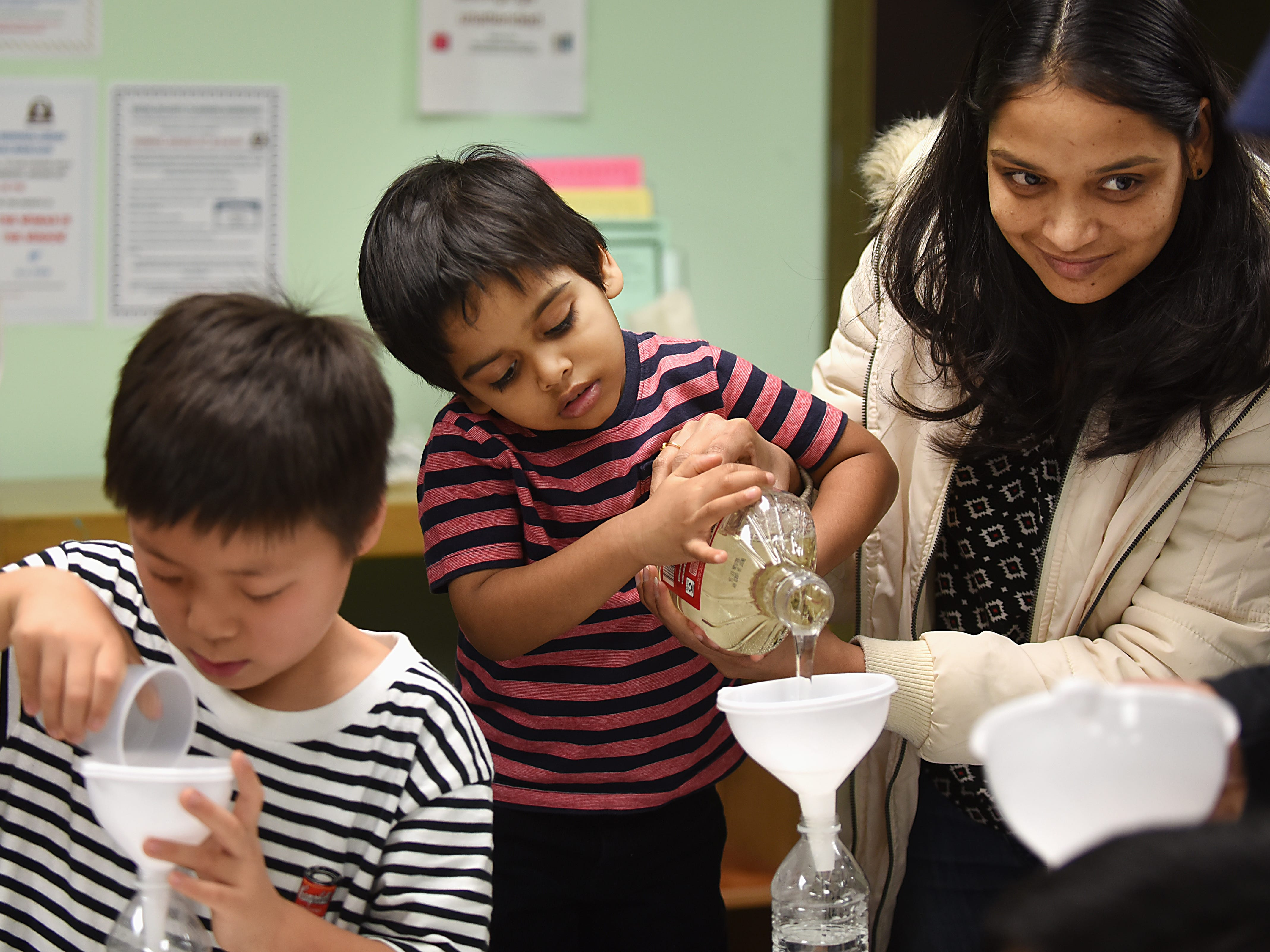 Children make a snowstorm in a bottle as part of the STEM Saturday series at East Rutherford Memorial Library on Saturday January 12, 2019. (From left) Dasel Paljor, 7, Advik Medibelly, 3 and Soumya Medibelly.
