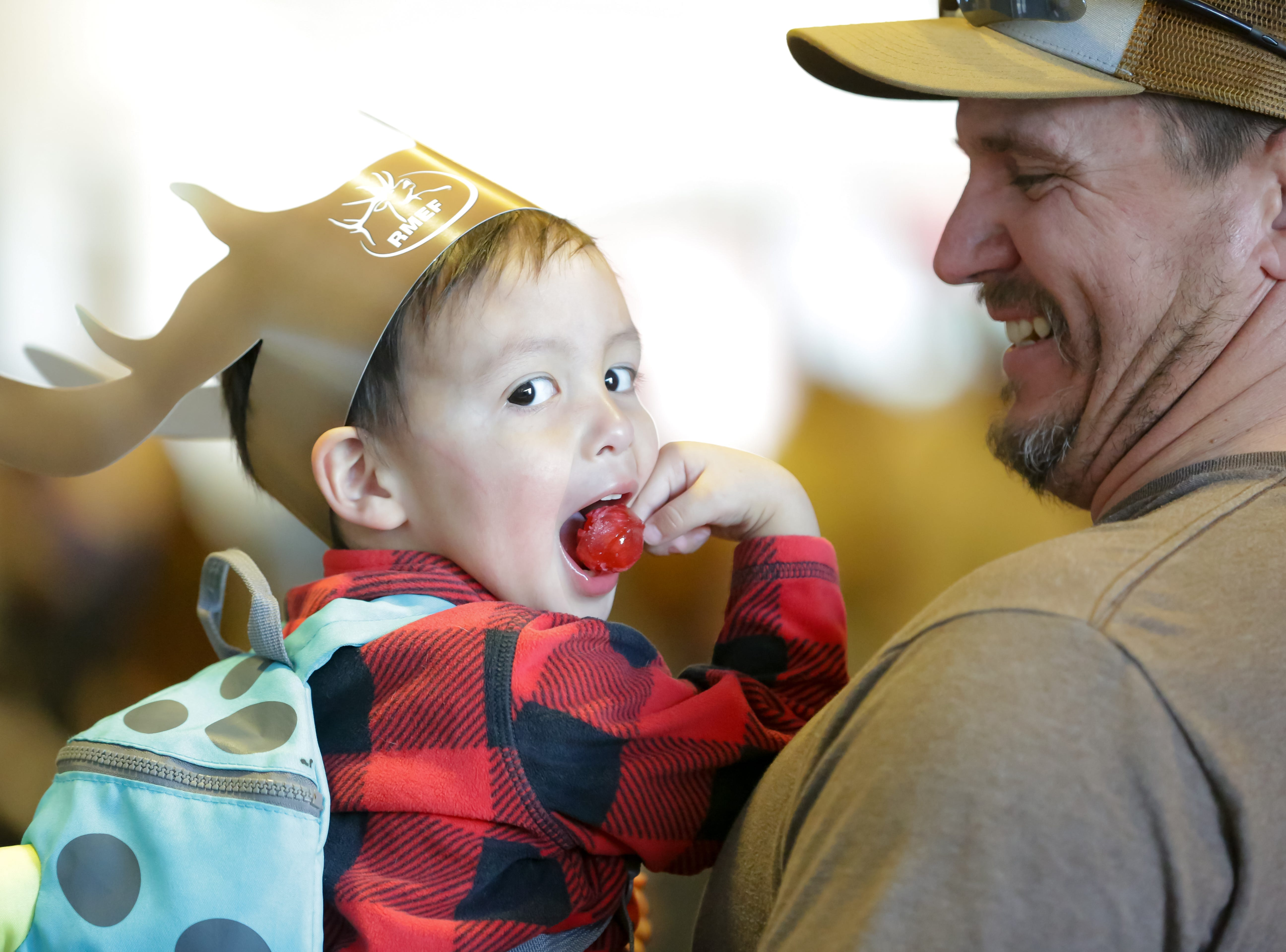Ezekiel White, 2, wears antlers and enjoys a lollipop while hanging out with his grandfather Loring White on Saturday, Jan. 12, 2019, during the 2019 Mesilla Valley Outdoor Expo at the Las Cruces Convention Center.
