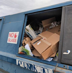 Unflattened cardboard boxes in the recycling center at the Old Foothills Landfill waste space that could be used for other residents. Take just a minute to flatten your boxes so that other have a chance to get their material in the blue bins.