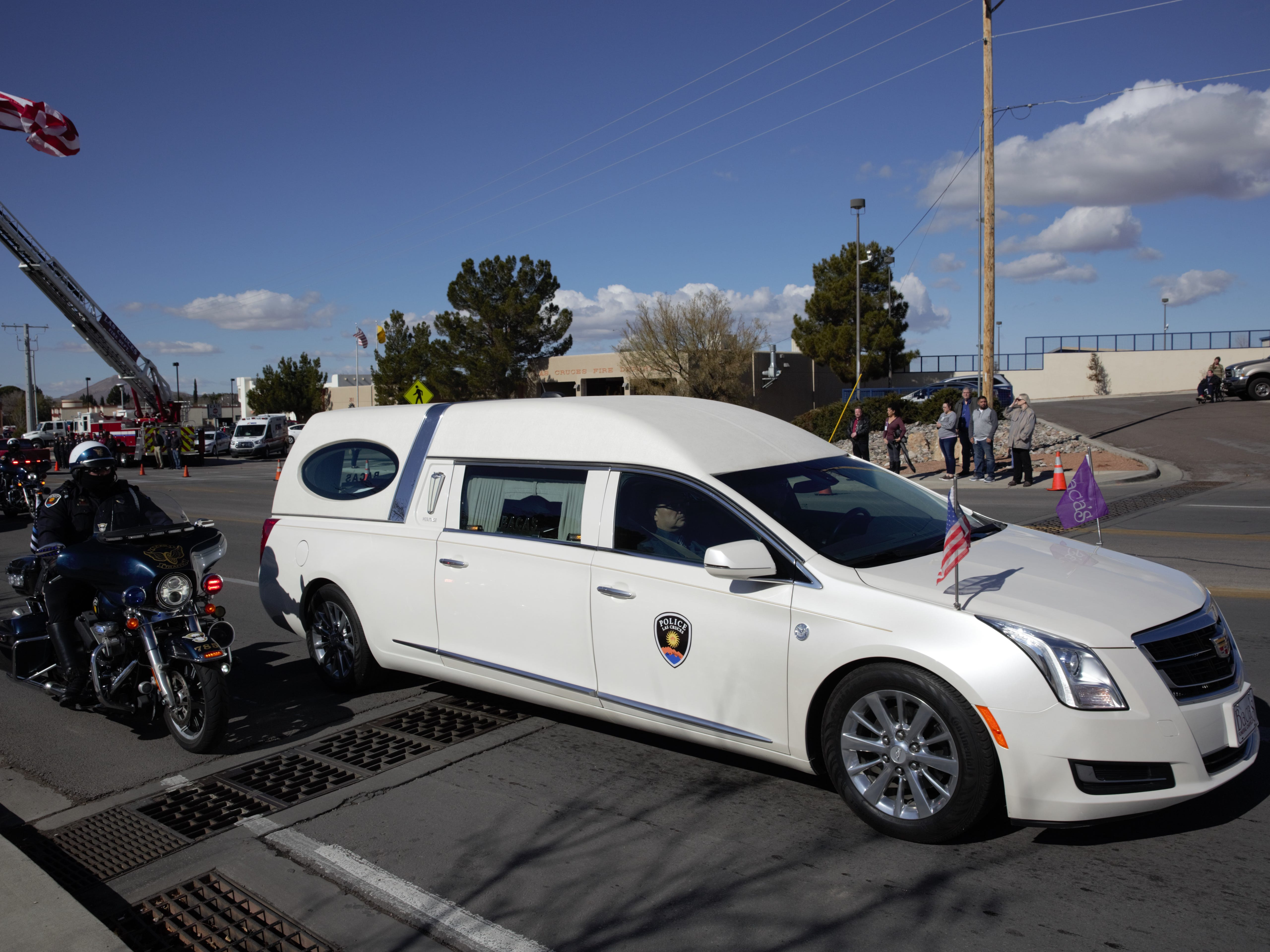 The hearse carrying the casket of former Las Cruces Police Chief Jaime Montoya is escorted by LCPD's motorcycle patrol on Friday, Jan. 11, 2019. The procession passed by the main Las Cruces police station on Picacho Avenue, where Montoya served as chief until his retirement in 2017. Montoya died recently at age 52.
