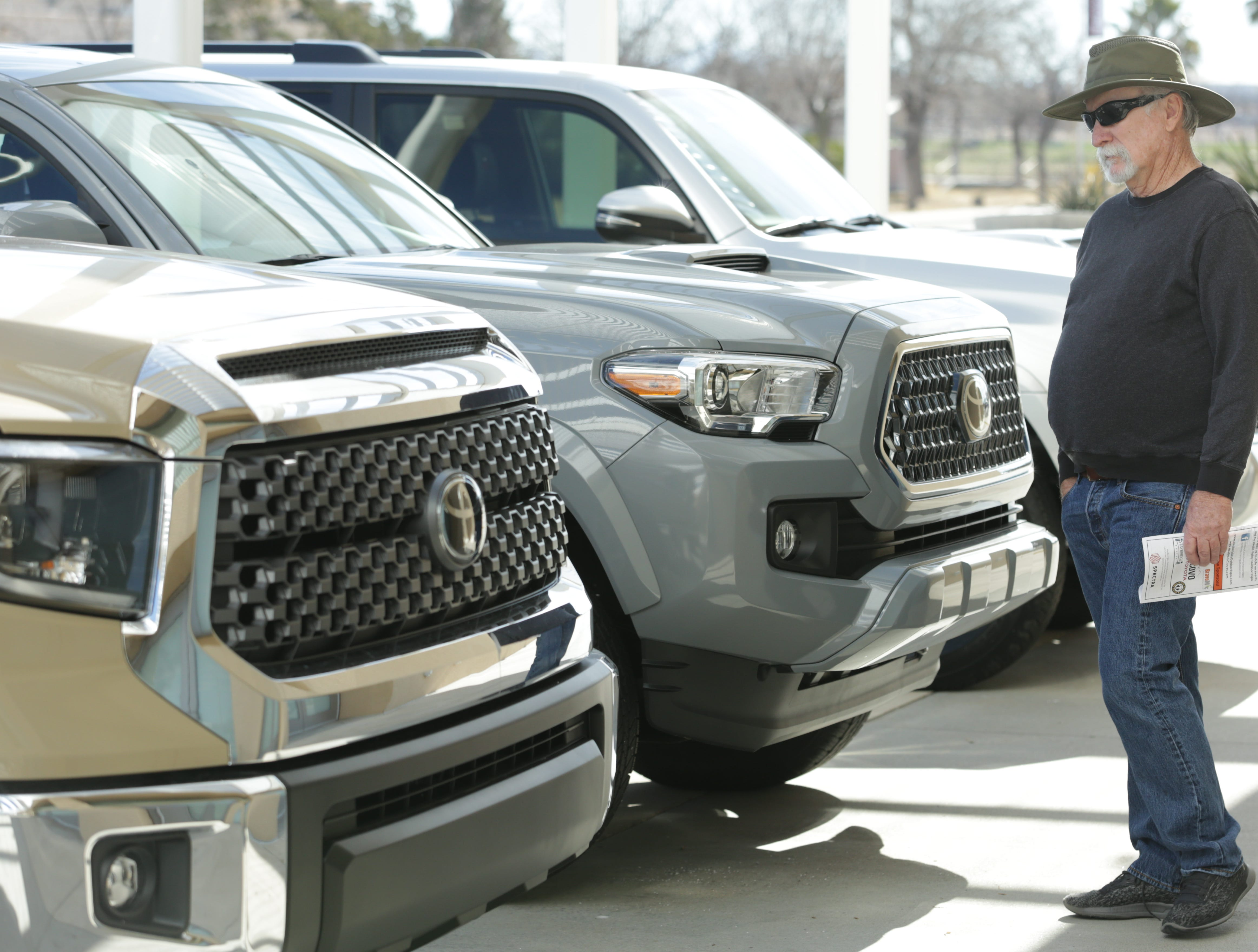 Toyota trucks are looked over by those attending the 2019 Mesilla Valley Outdoor Expo on Saturday, Jan. 12, 2019, at the Las Cruces Convention Center.