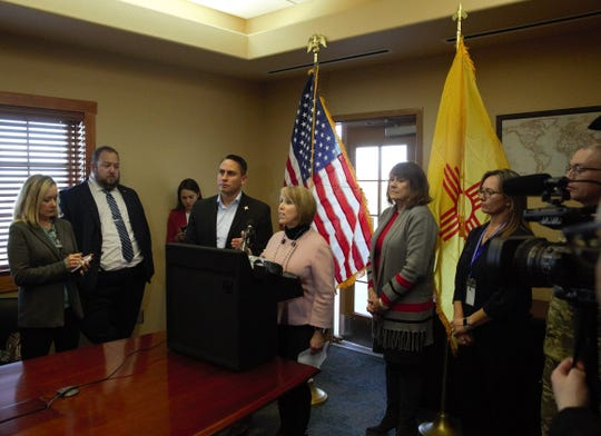 Surrounded by other state officials, New Mexico Gov. Michelle Lujan Grisham, center, recounts on Friday, Jan. 11, 2019 details of her tour of the southern New Mexico border near Sunland Park and Santa Teresa, New Mexico.