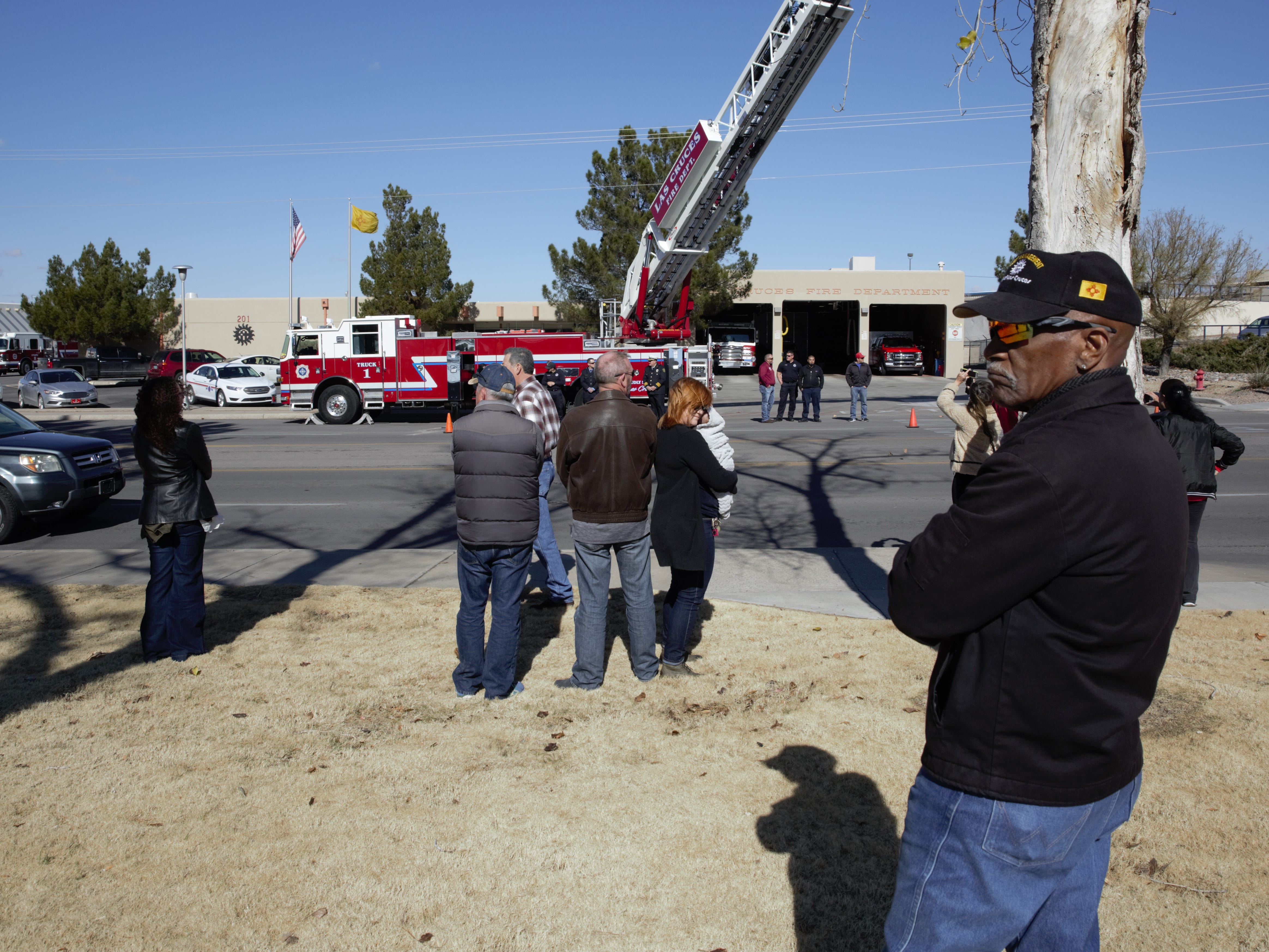 """James Hill, a fleet service writer for the city and a former LCPD officer, awaits the arrival of a funeral procession on Picacho Avenue. Hill says he worked under former Las Cruces Police Chief Jaime Montoya for about six years and was """"very happy"""" when Montoya was named chief. Hill says he was shocked to hear of Montoya's recent death, which came not long after his retirement."""