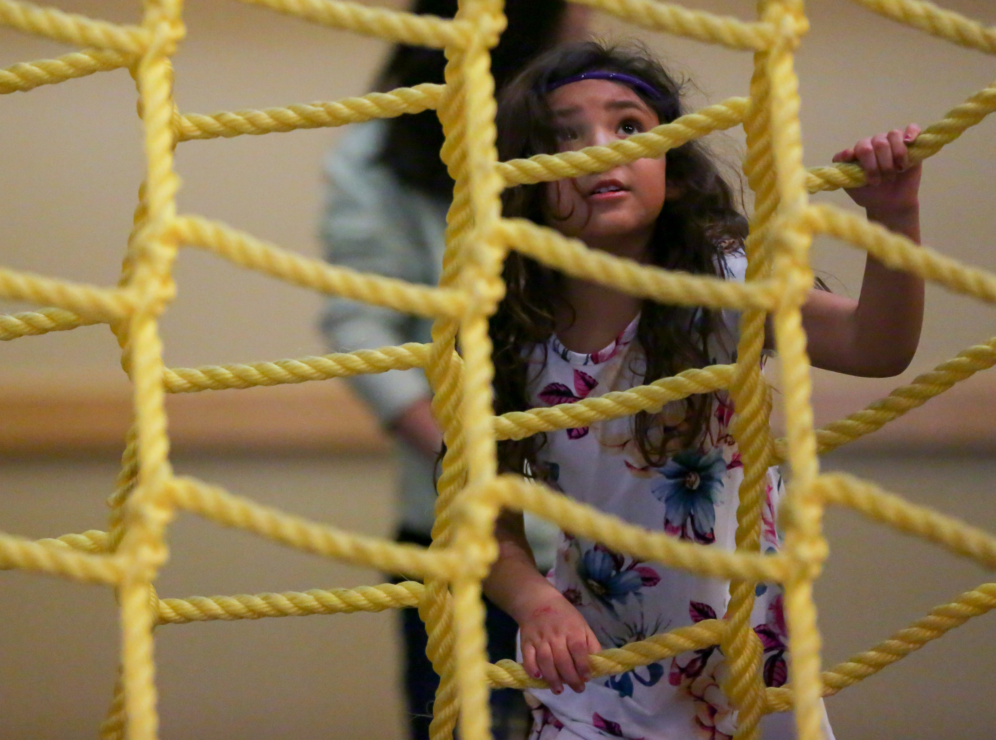 Annais Moreno, 5, climbs a rope latter while playing in an obstacle course on Saturday, Jan. 12, 2019, during the 2019 Mesilla Valley Outdoor Expo at the Las Cruces Convention Center.