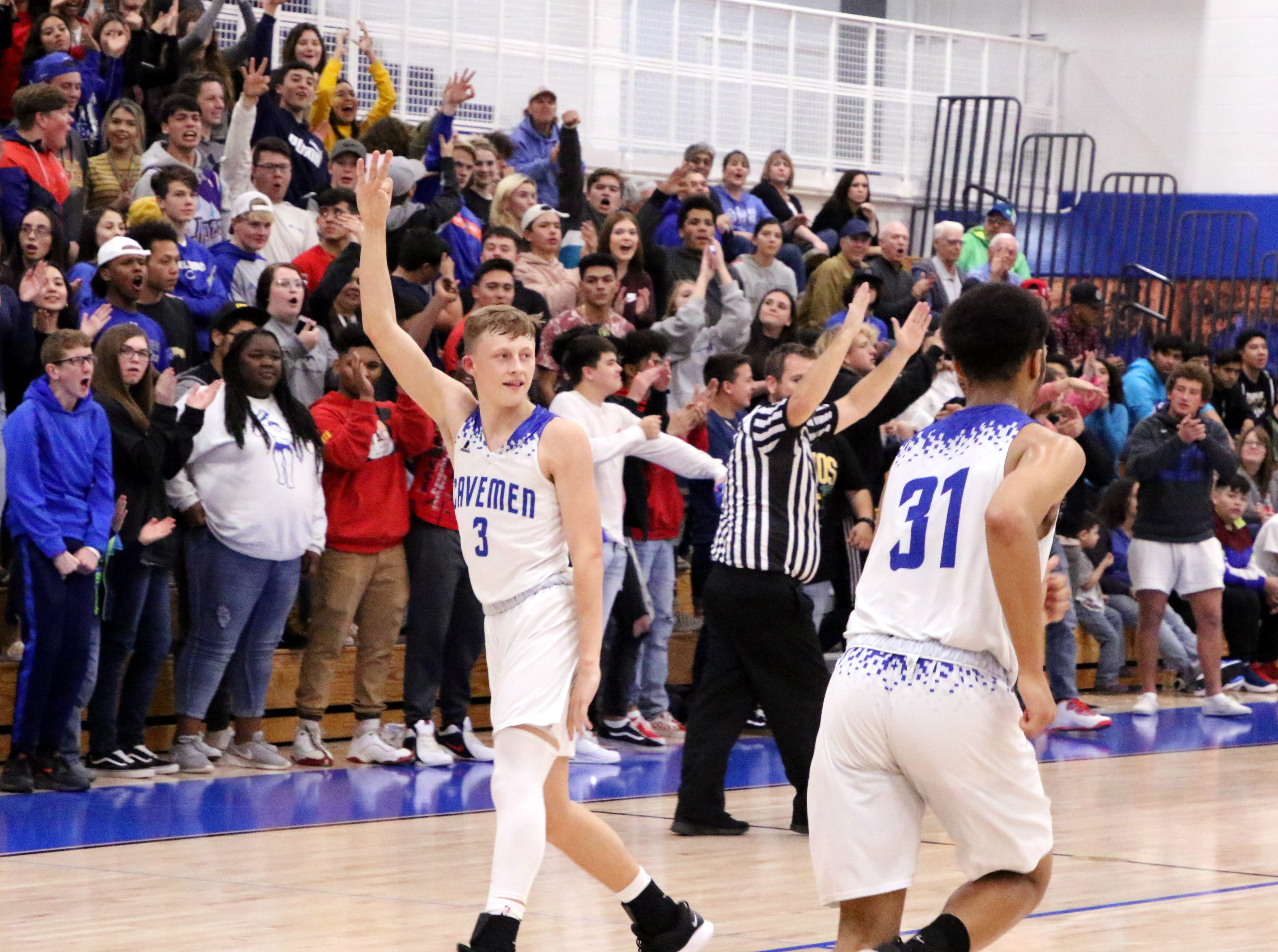 Riley Hestand (3) celebrates making a three-pointer to start out the fourth quarter on Friday. Carlsbad went on a 7-0 to start the quarter en route to a 66-49 win over Gadsden.