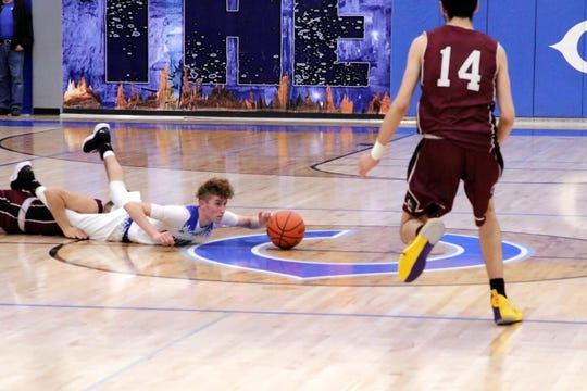 Josh Sillas dives for a loose ball in the second half of Friday's game against Gadsden.