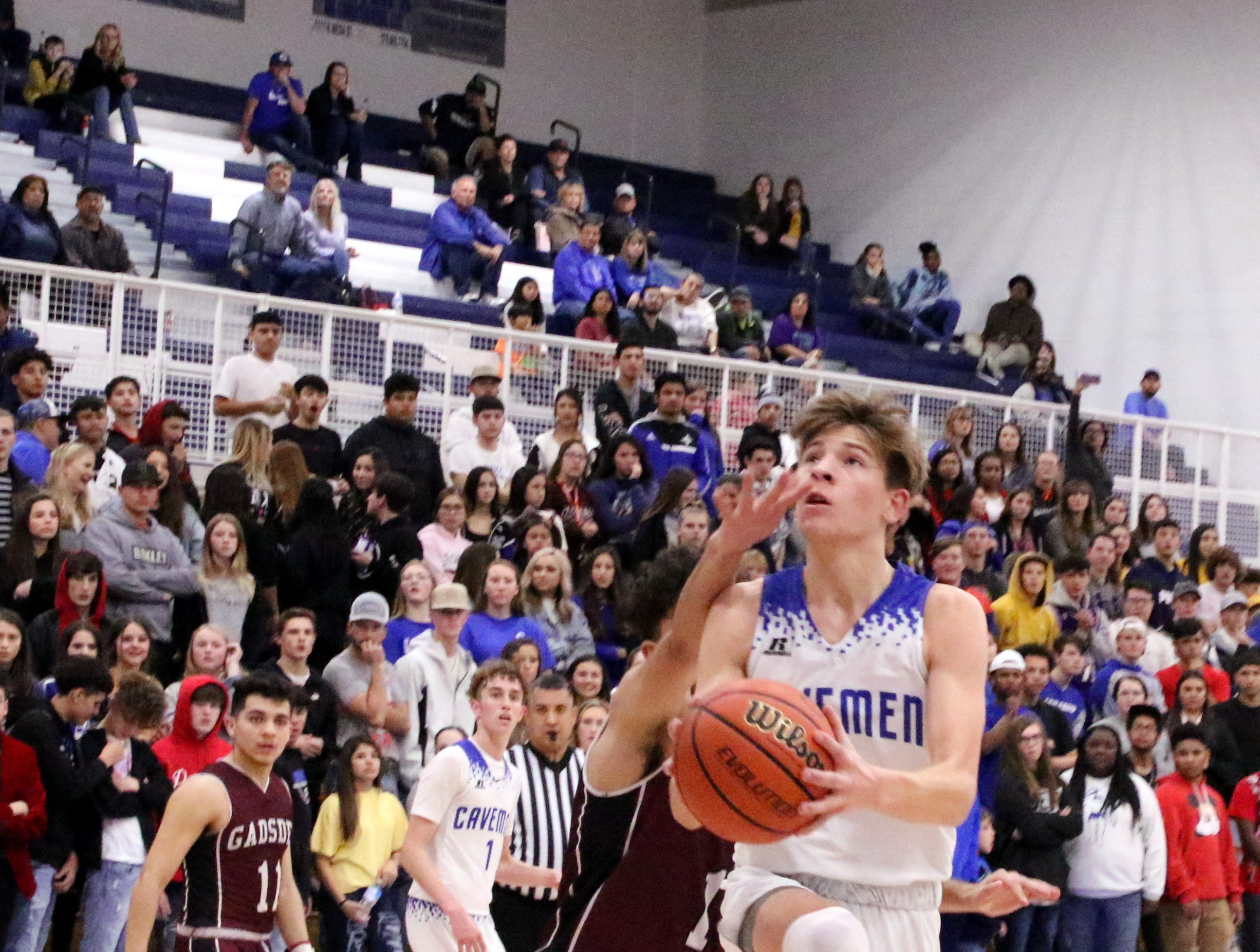 Carlsbad's Stevie Bartlett is fouled as he shoots a layup in the fourth quarter against Gadsden on Friday.