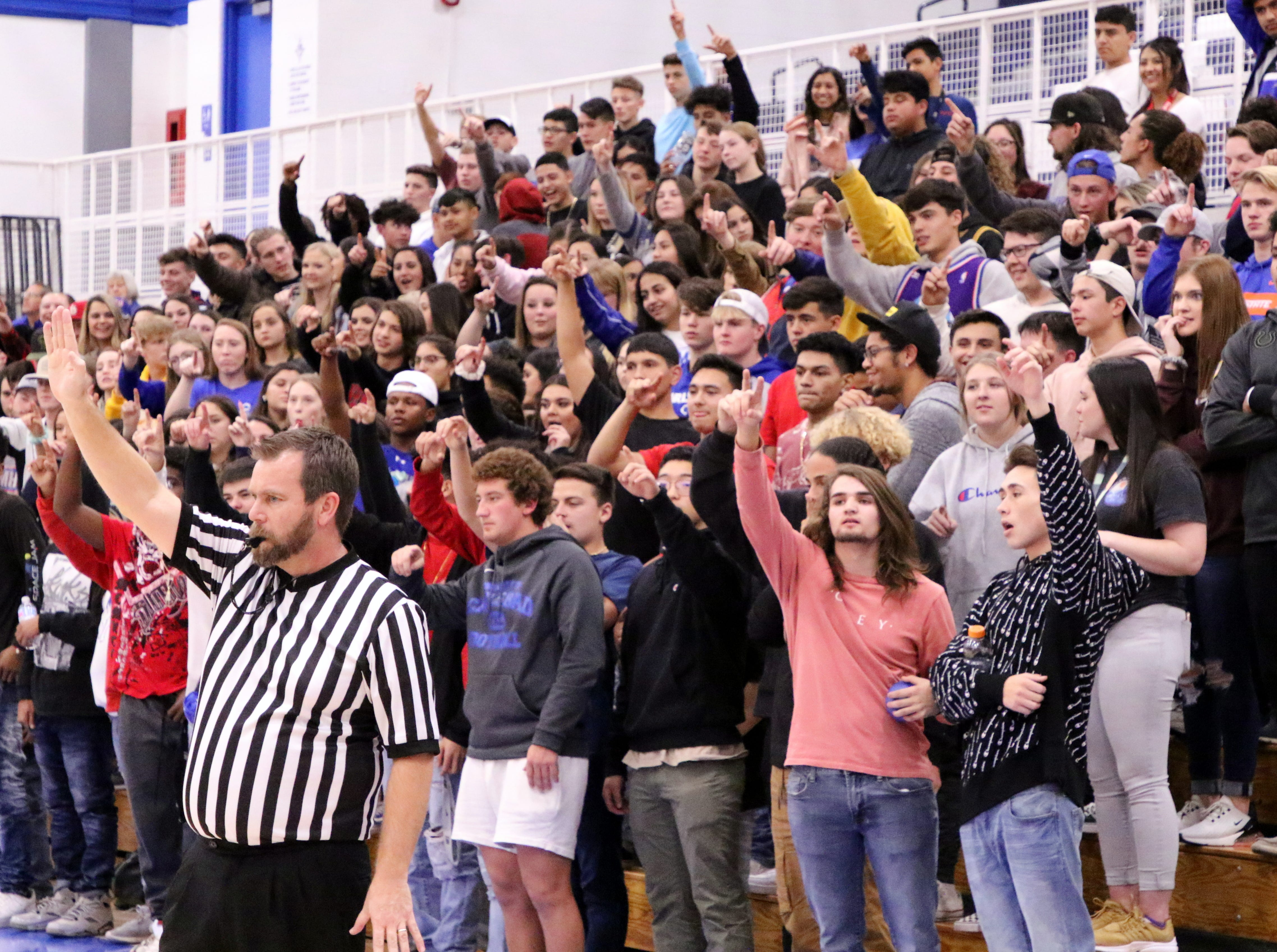 The Carlsbad crowd reacts to a three-point shot in the first half of Friday's game against Gadsden.