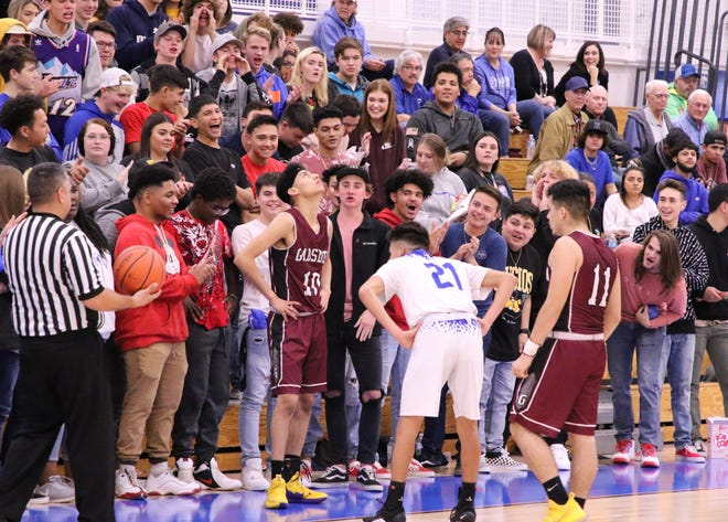 The Carlsbad fans make it extra loud for Gadsden's Diego Hernandez (10) before he inbounds the during Friday's game.