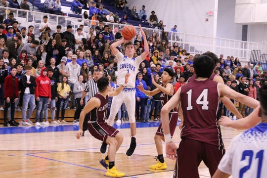 Josh Sillas gets off a shot in the second half of Friday's game against Gadsden.