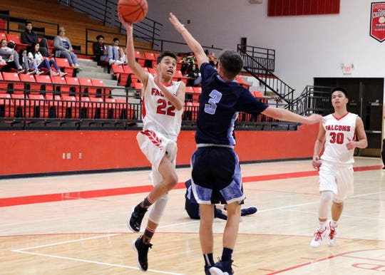 Brian Gutierrez goes for a layup in the first half of Saturday's game against Goddard. He finished with seven points.
