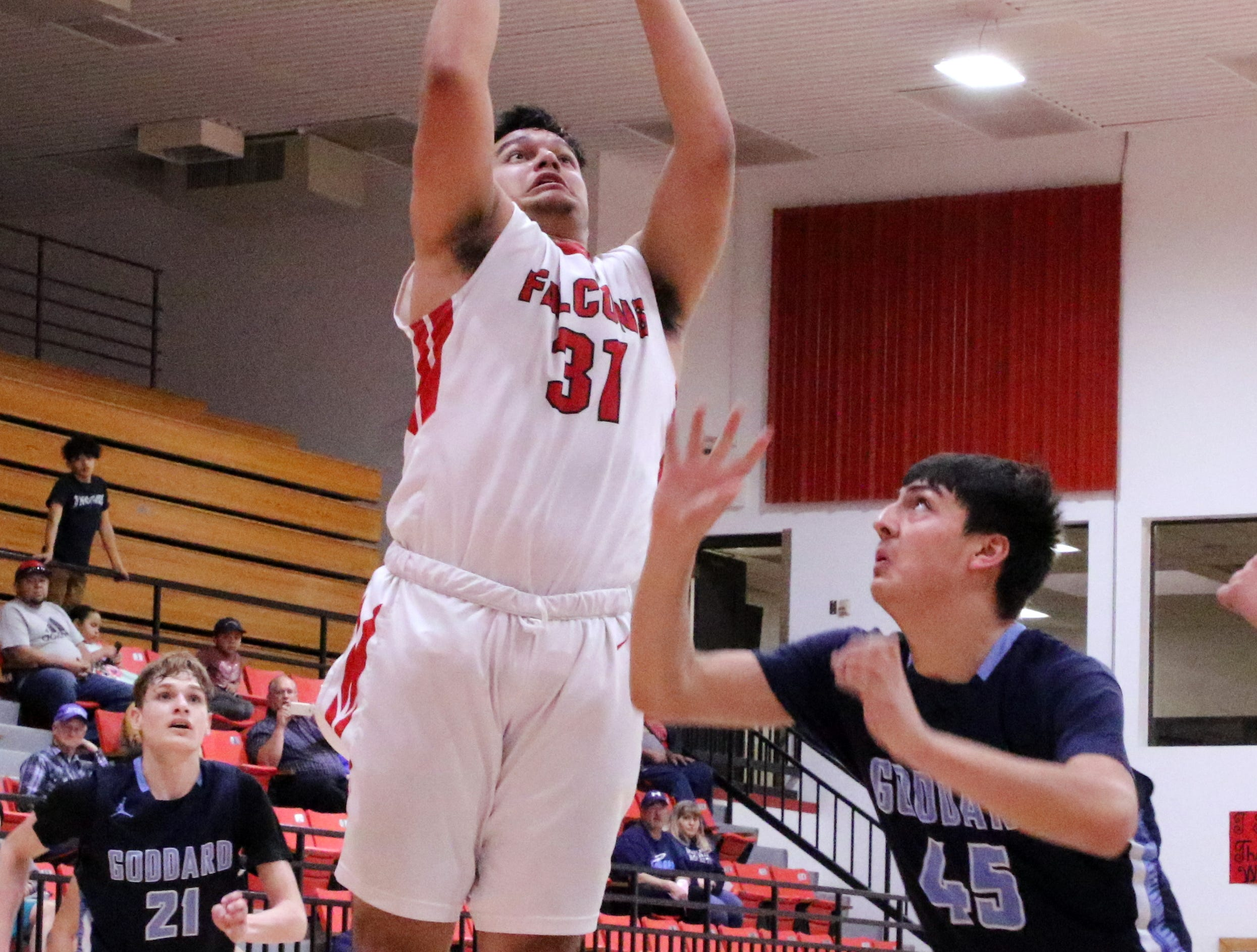 Kevin Porras puts up a layup in the fourth quarter of Saturday's game against Goddard.