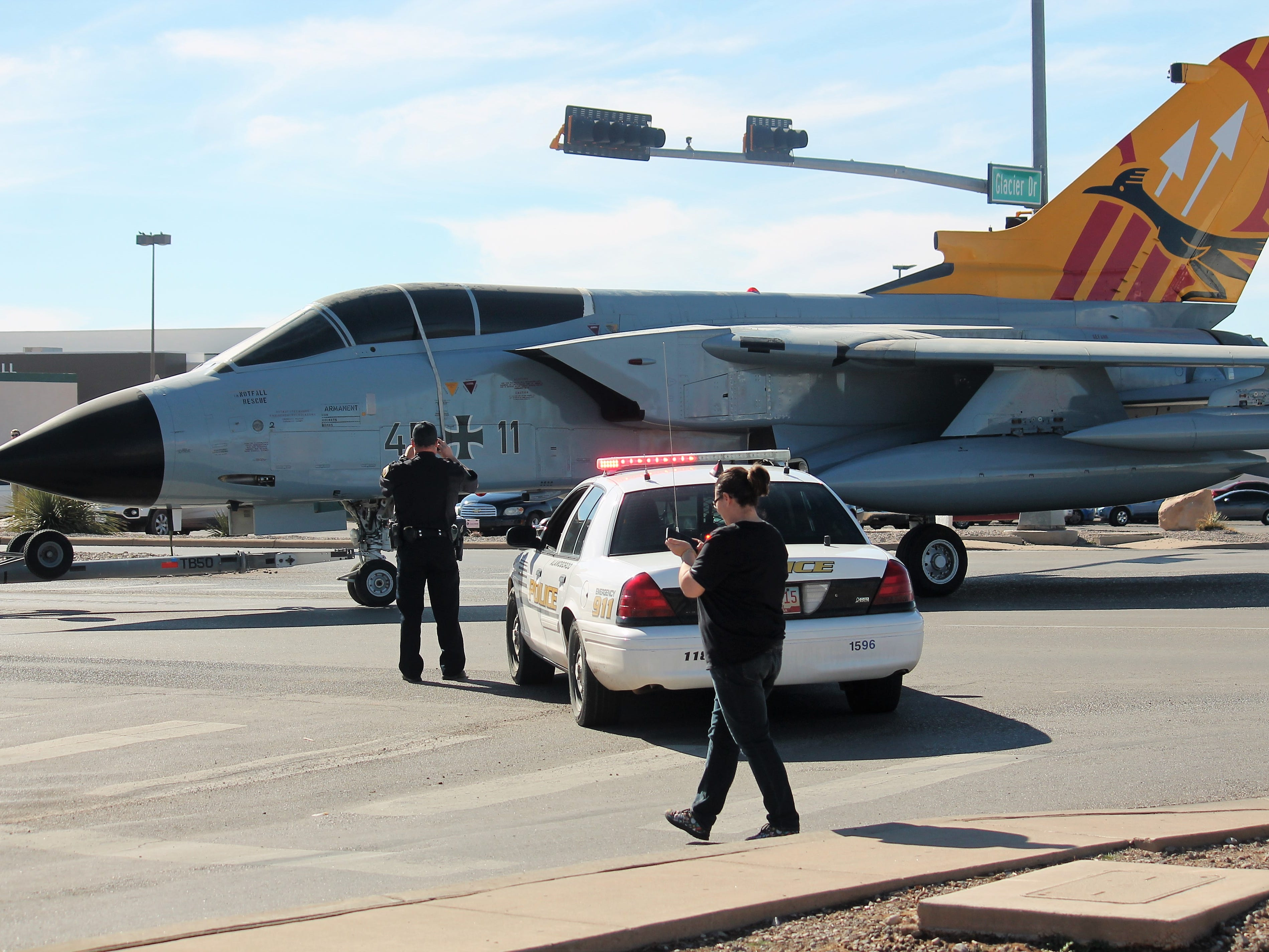 Tow crews maneuver the Tornado jet through the traffic lights at White Sands Boulevard and Glacier Drive with the assistance of an Alamogordo Police officer Saturday.