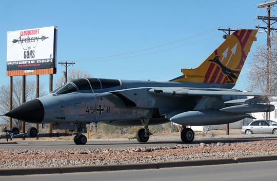 The German air force Tornado jet fighter makes its way down Highway 54/70 while being towed to Alamogordo Saturday.