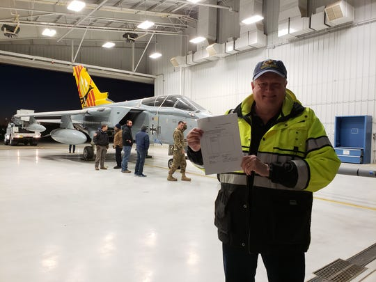 Museum of Space History Executive Director Chris Orwoll inside the hangar at Holloman Air Force Base where the German air force Tornado was being prepped to move Saturday morning, Jan. 12, 2019 at 6:30 a.m. He's holding the donation paperwork that makes the jet fighter officially the property of the museum.