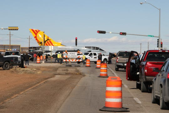Traffic backs up on Highway 54/70 while tow crew members hand turn the Tornado jet from La Luz Gate Road onto the highway Saturday.