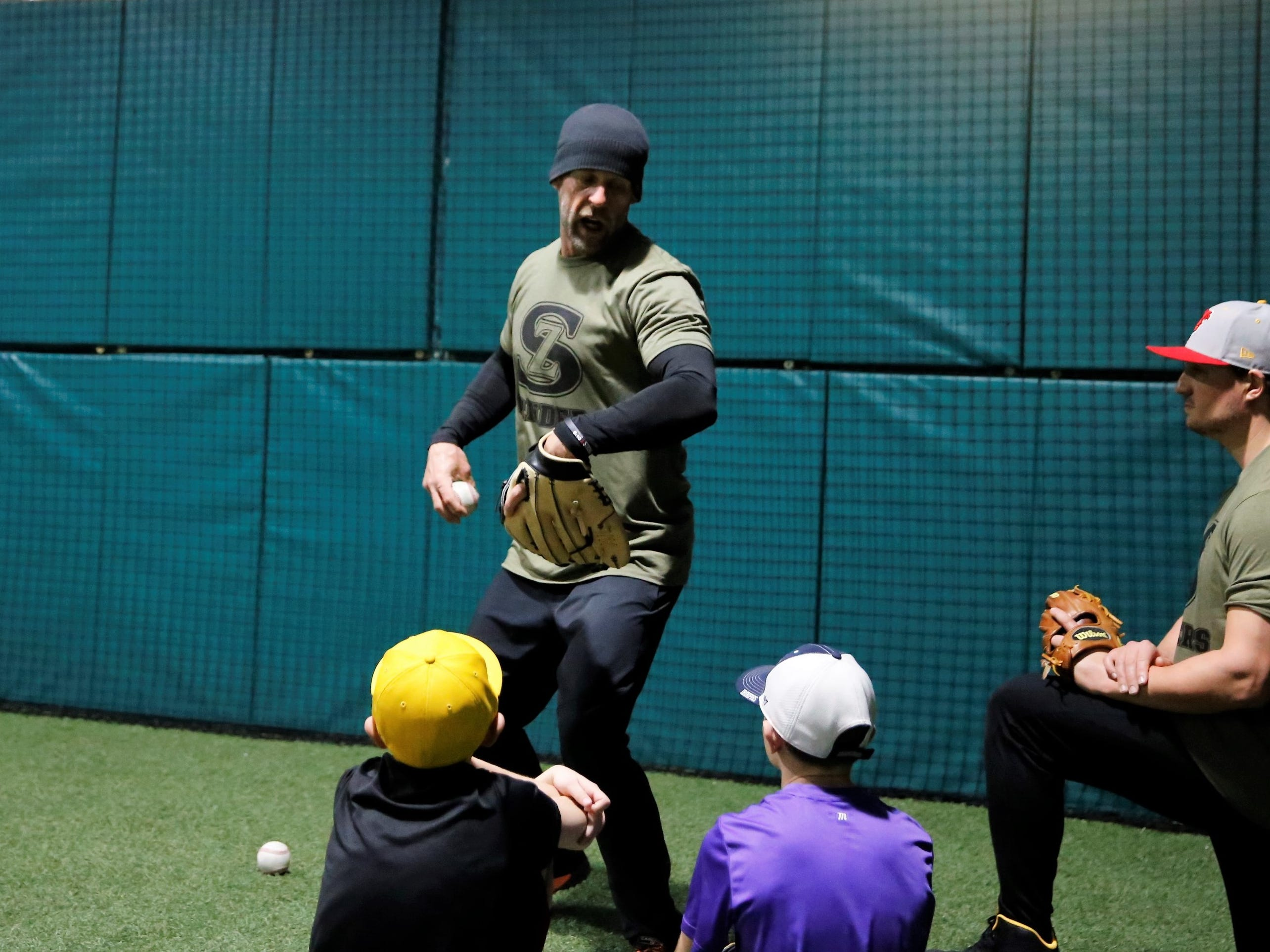 Grinders for Grace baseball camp instructor Adam Morrissey teaches footwork and form during fielding drills Saturday at the Strike Zone training facility in Farmington. The camp raised more than $75,000 to help pay medical bills for Morrissey's daughter, Grace Morrissey.