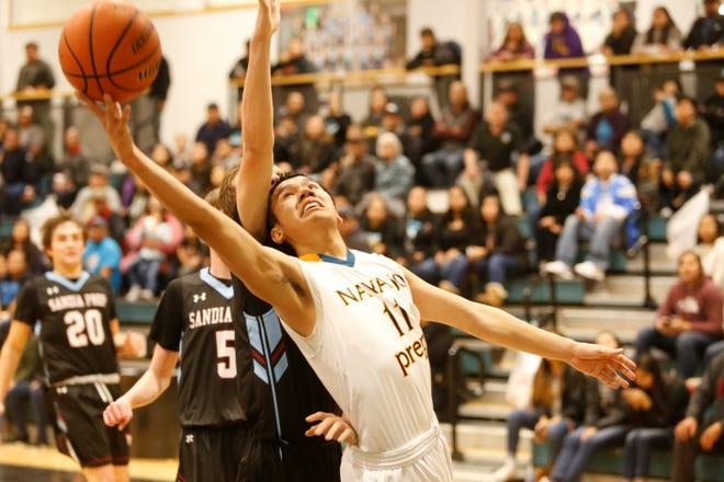 Navajo Prep's Thomas Montanez attacks the basket against Sandia Prep during Friday's game at the Eagles Nest in Farmington.