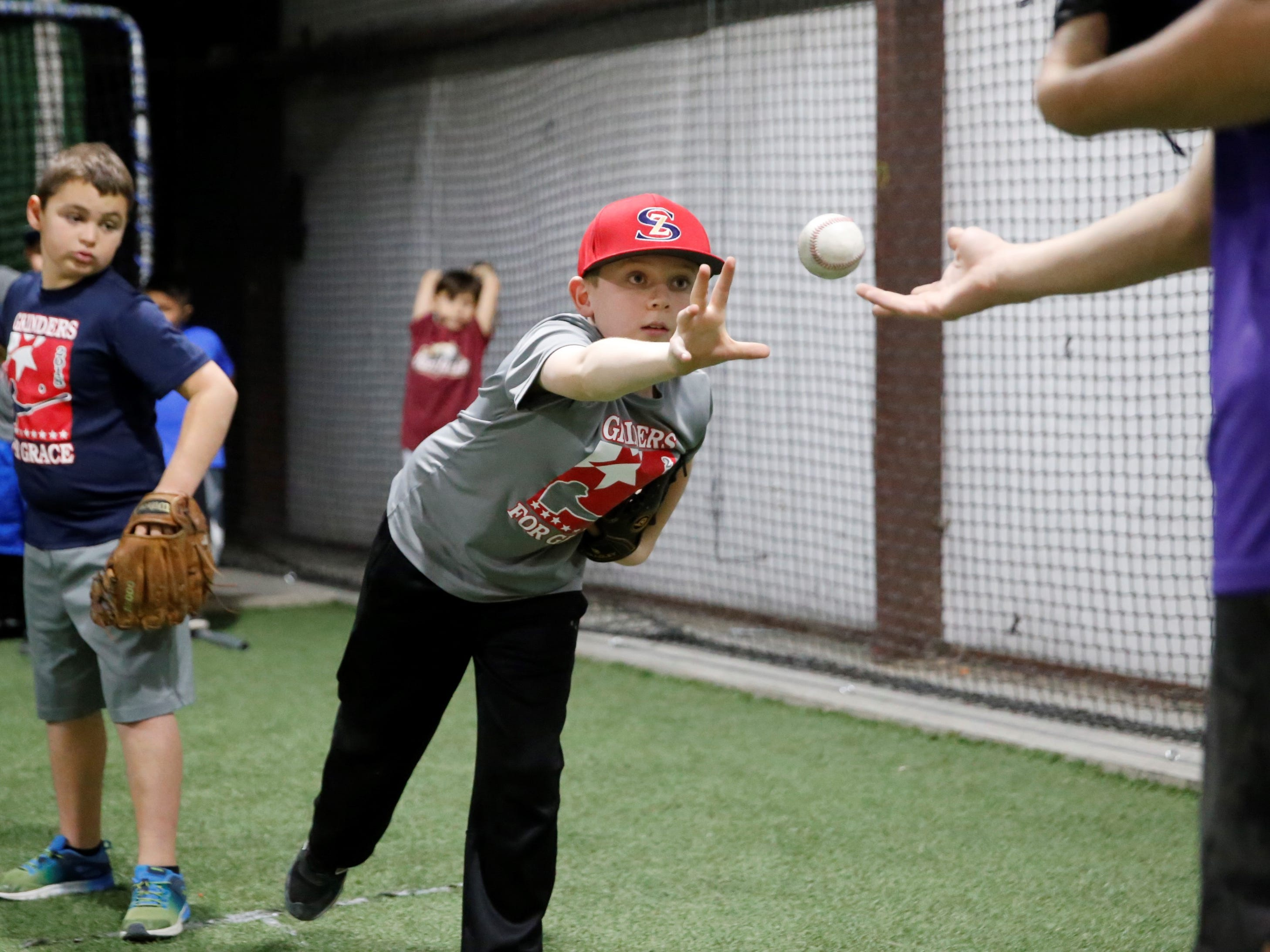 Logan Rowland of Farmington works on his balance during pitching drills at the fourth annual Grinders for Grace baseball camp Saturday at the Strike Zone training facility in Farmington.