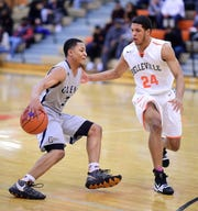 John Glenn's Joe Moon IV (left) takes Belleville's Jamari Buddin off the dribble on his way to a school-record 44 points.