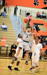 John Glenn's Joe Moon goes in for two of his school-record 44 points in an 81-78 OT loss at Belleville.