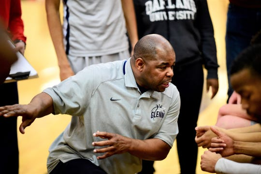 John Glenn coach Rod Watts instructs his team during a timeout against Belleville.