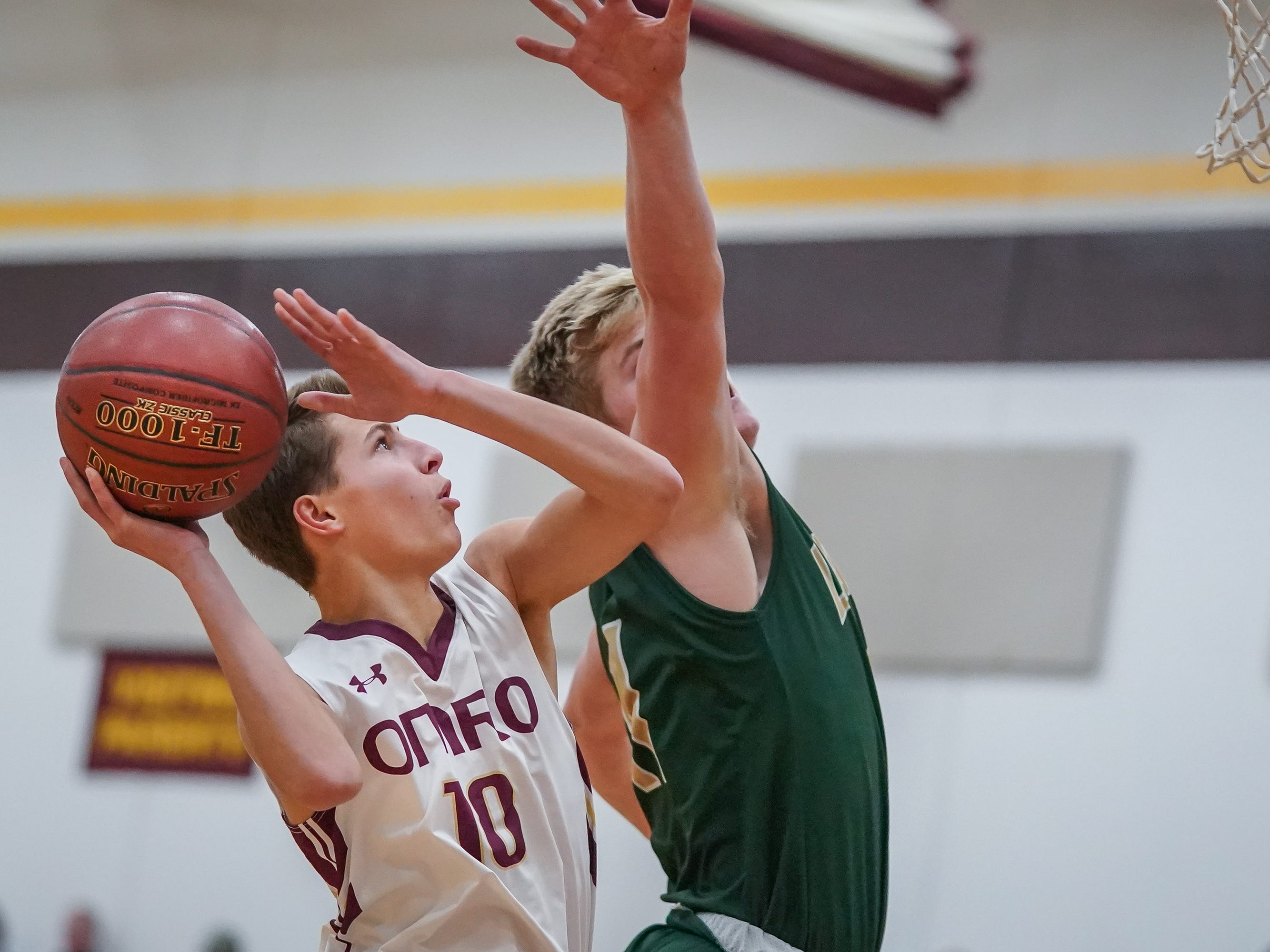 Cade Stachura (10) of Omro goes up for a shot. The Omro Foxes hosted the Laconia Spartans in a Flyway Conference basketball game Friday evening, January 11, 2019.