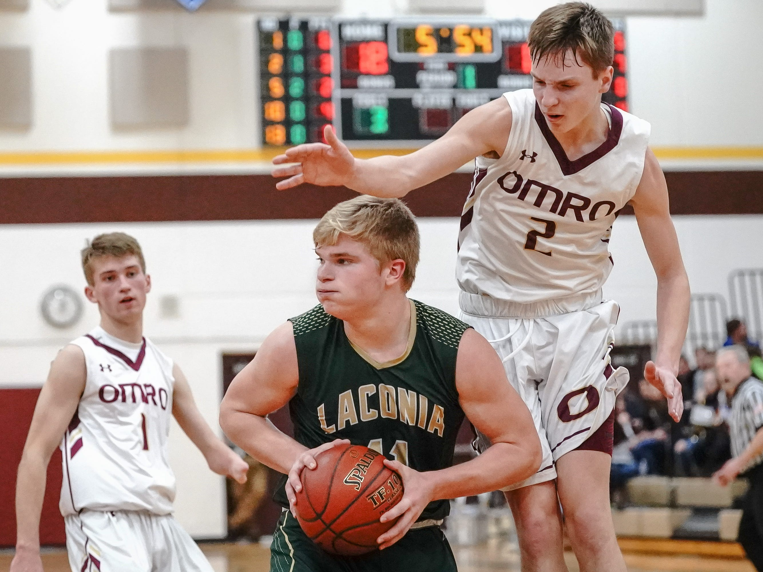Carter Huth (2) of Omro tries to block Eli Leonard (11) of Laconia.  The Omro Foxes hosted the Laconia Spartans in a Flyway Conference basketball game Friday evening, January 11, 2019.