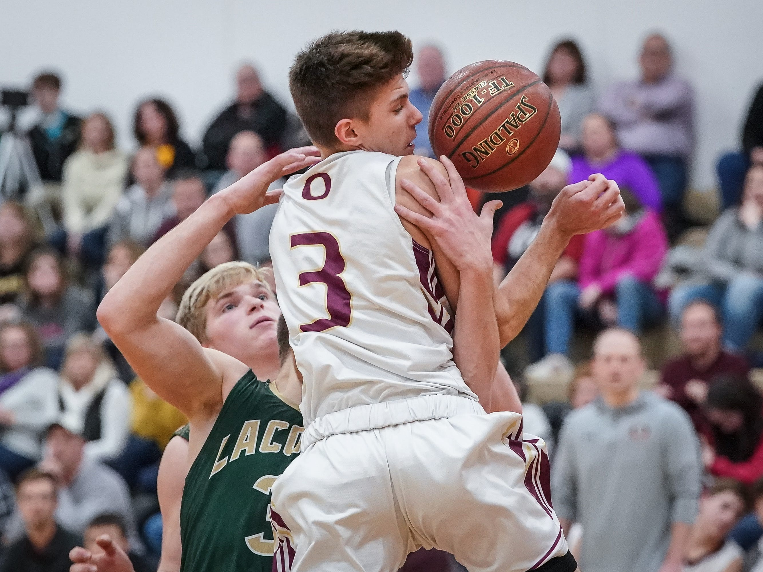Austin Bauer (3) of Omro battles Reed Gunnink (3) of Laconia. The Omro Foxes hosted the Laconia Spartans in a Flyway Conference basketball game Friday evening, January 11, 2019.