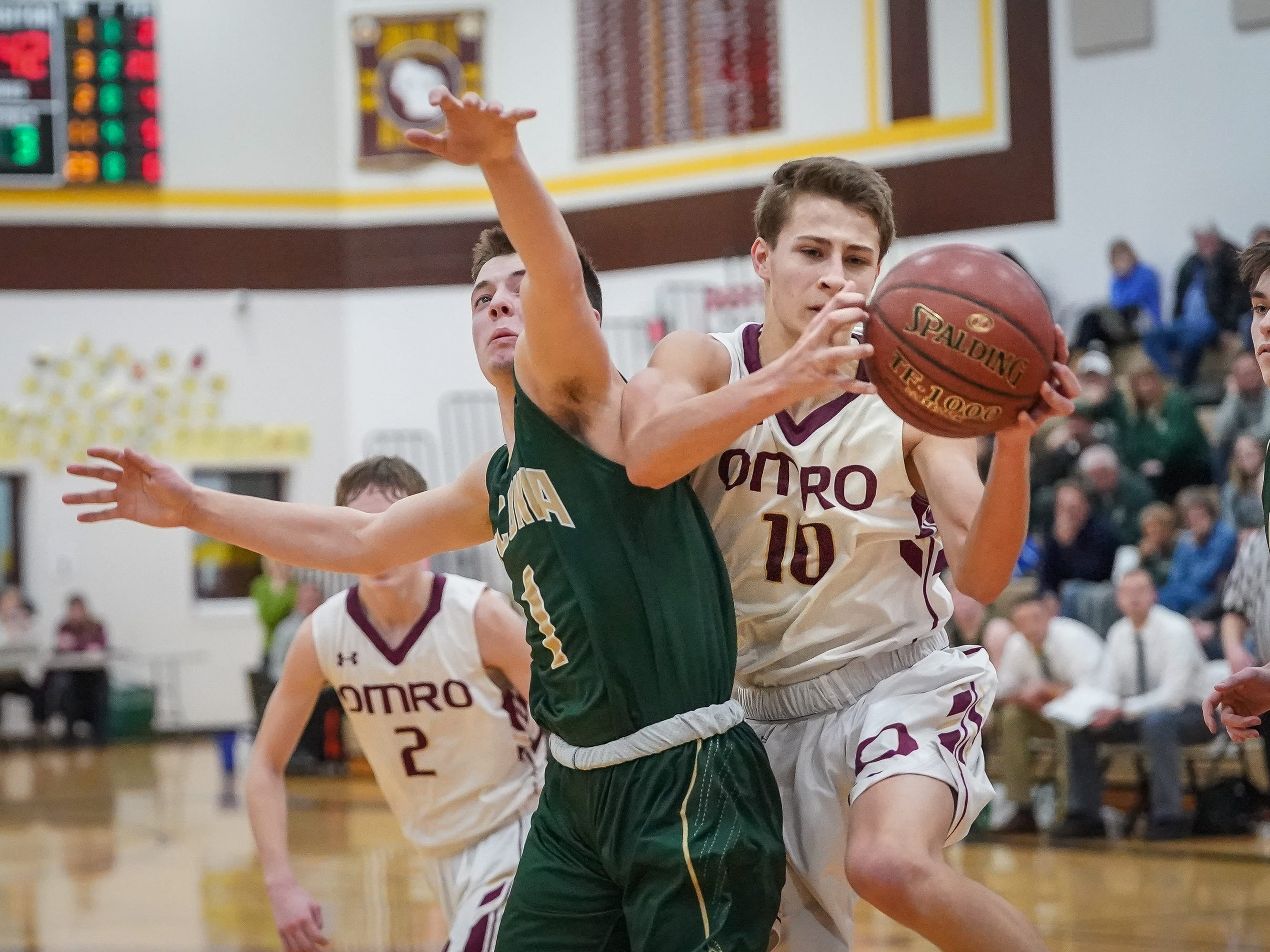 Cade Stachura (10) of Omro battles with Jack Walters (1) of Laconia for a loose ball. The Omro Foxes hosted the Laconia Spartans in a Flyway Conference basketball game Friday evening, January 11, 2019.