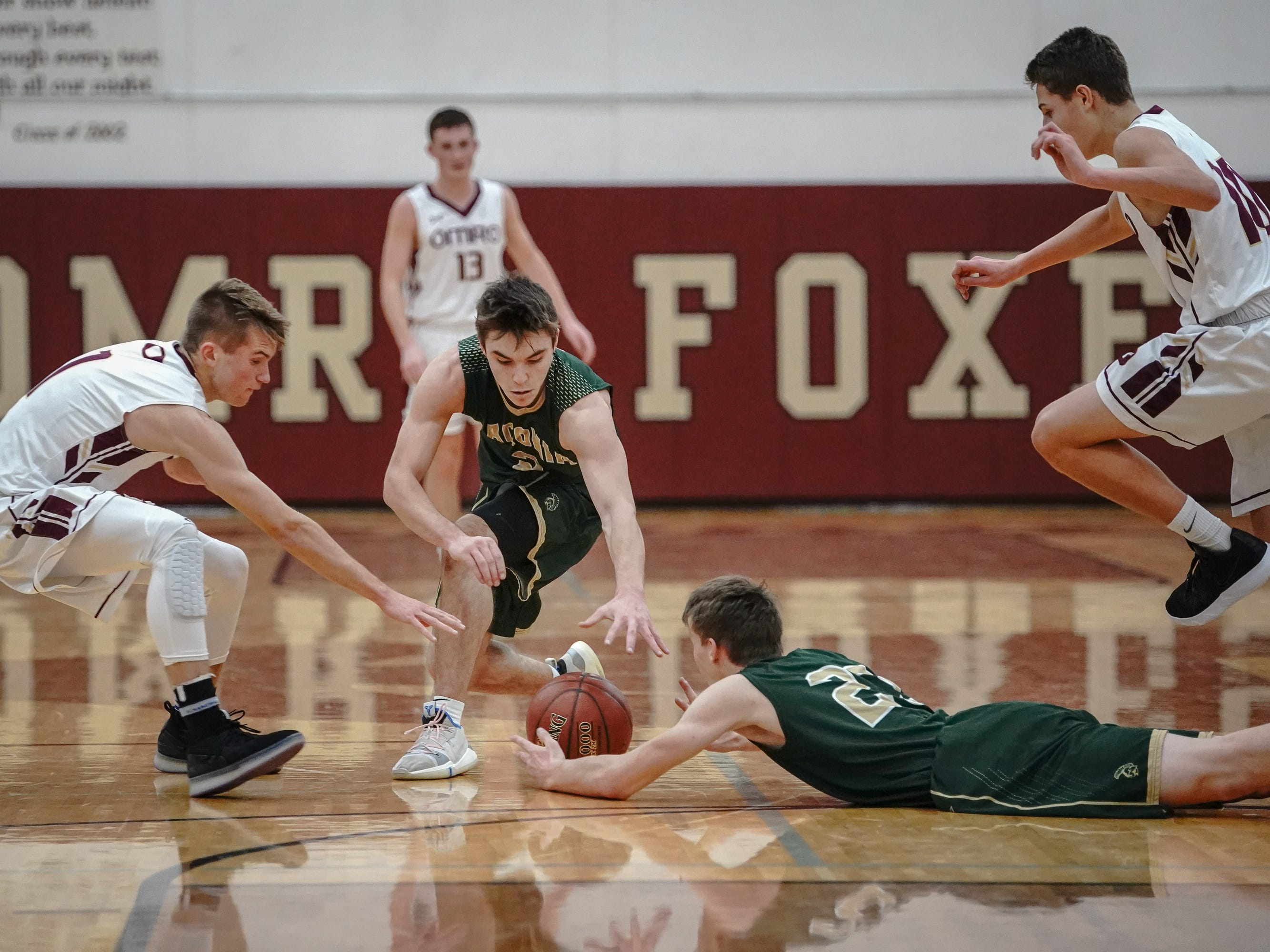 Dawson Drews (23) of Laconia scrambles for a loose ball. The Omro Foxes hosted the Laconia Spartans in a Flyway Conference basketball game Friday evening, January 11, 2019.