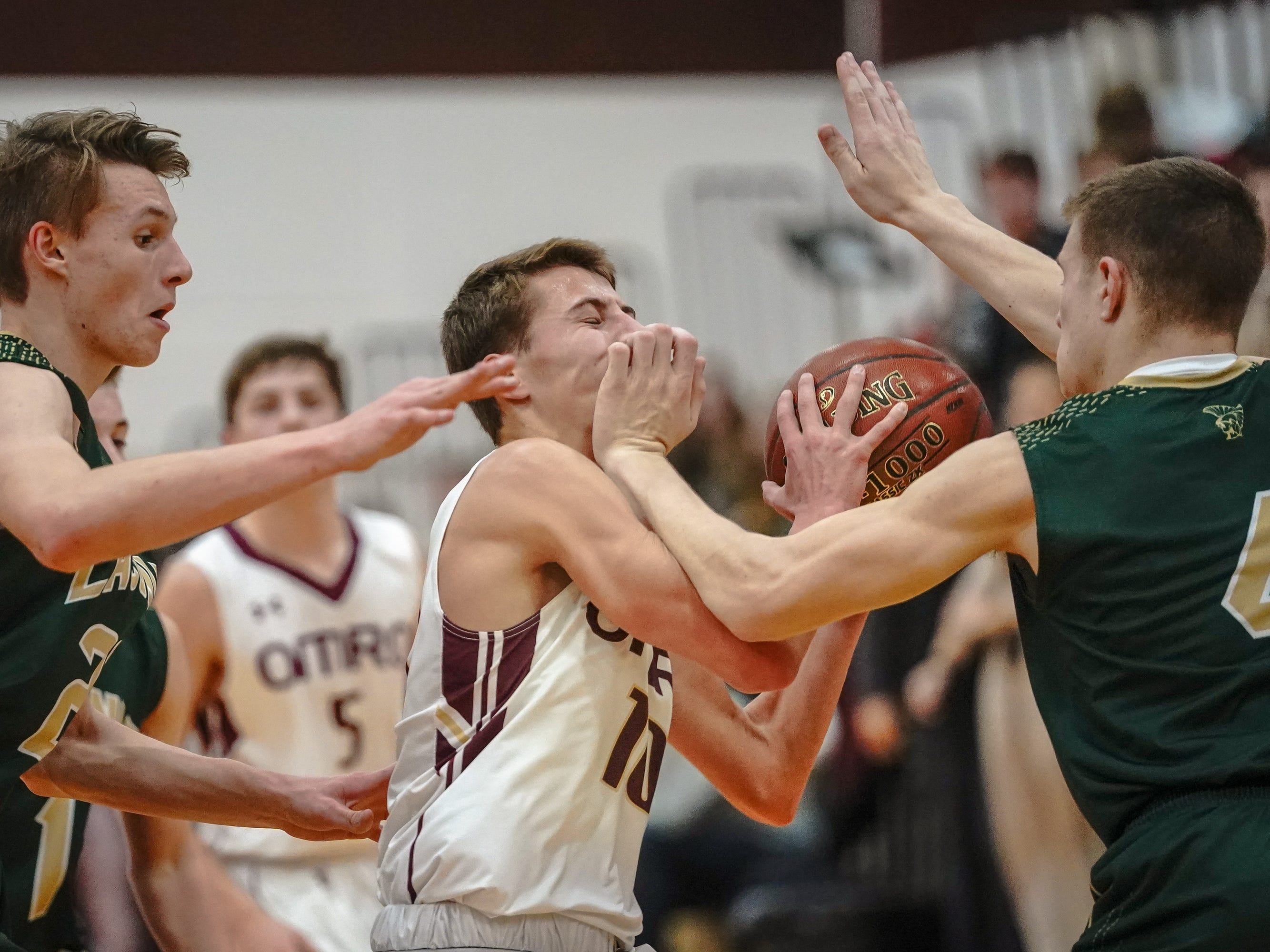 Cade Stachura (10) of Omro gets blocked by Jake Davies (4) of Laconia. The Omro Foxes hosted the Laconia Spartans in a Flyway Conference basketball game Friday evening, January 11, 2019.