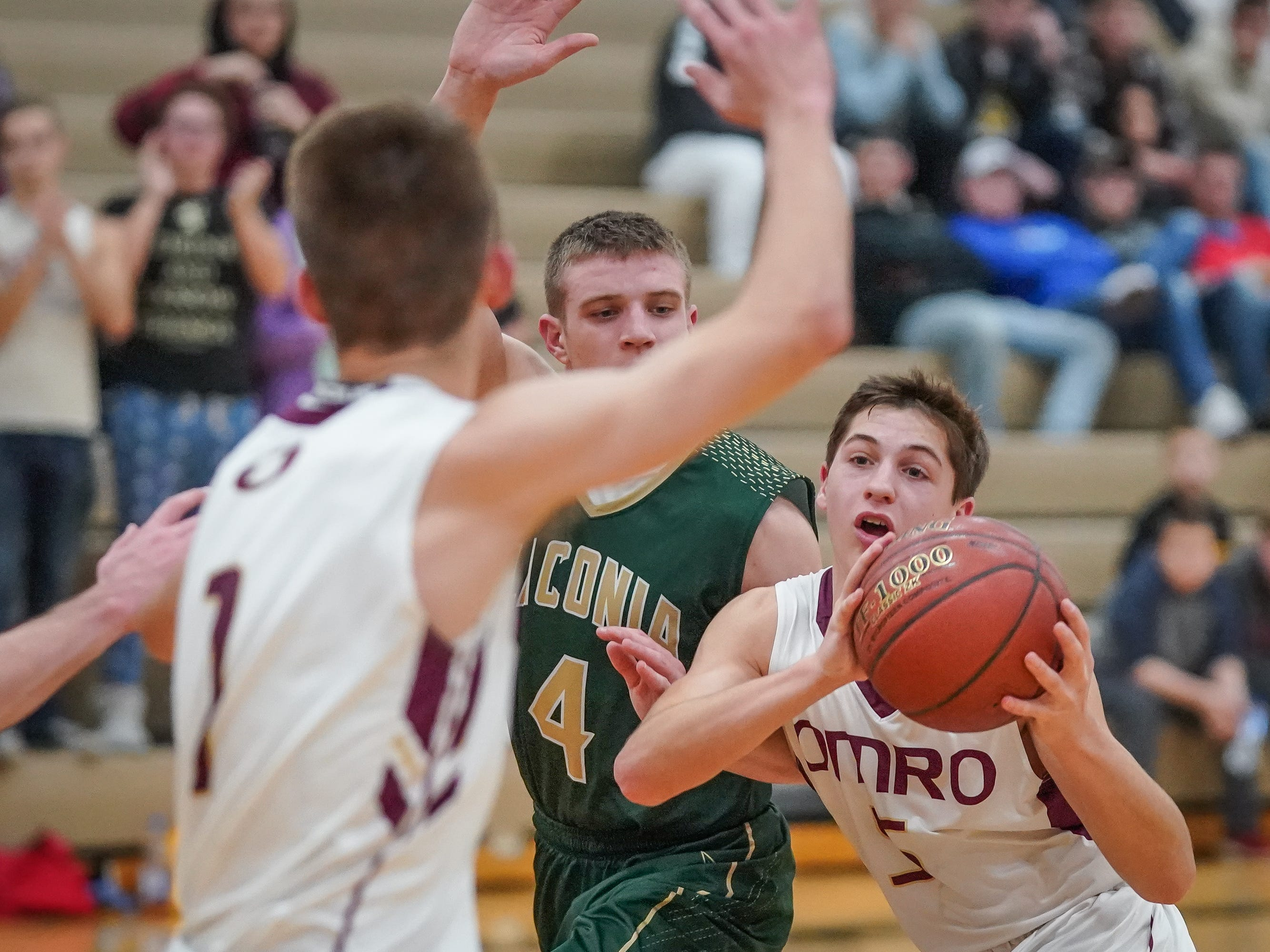 Cody Schoeni (5) of Omro gets ready to pass to Trevor Molitor (1). The Omro Foxes hosted the Laconia Spartans in a Flyway Conference basketball game Friday evening, January 11, 2019.