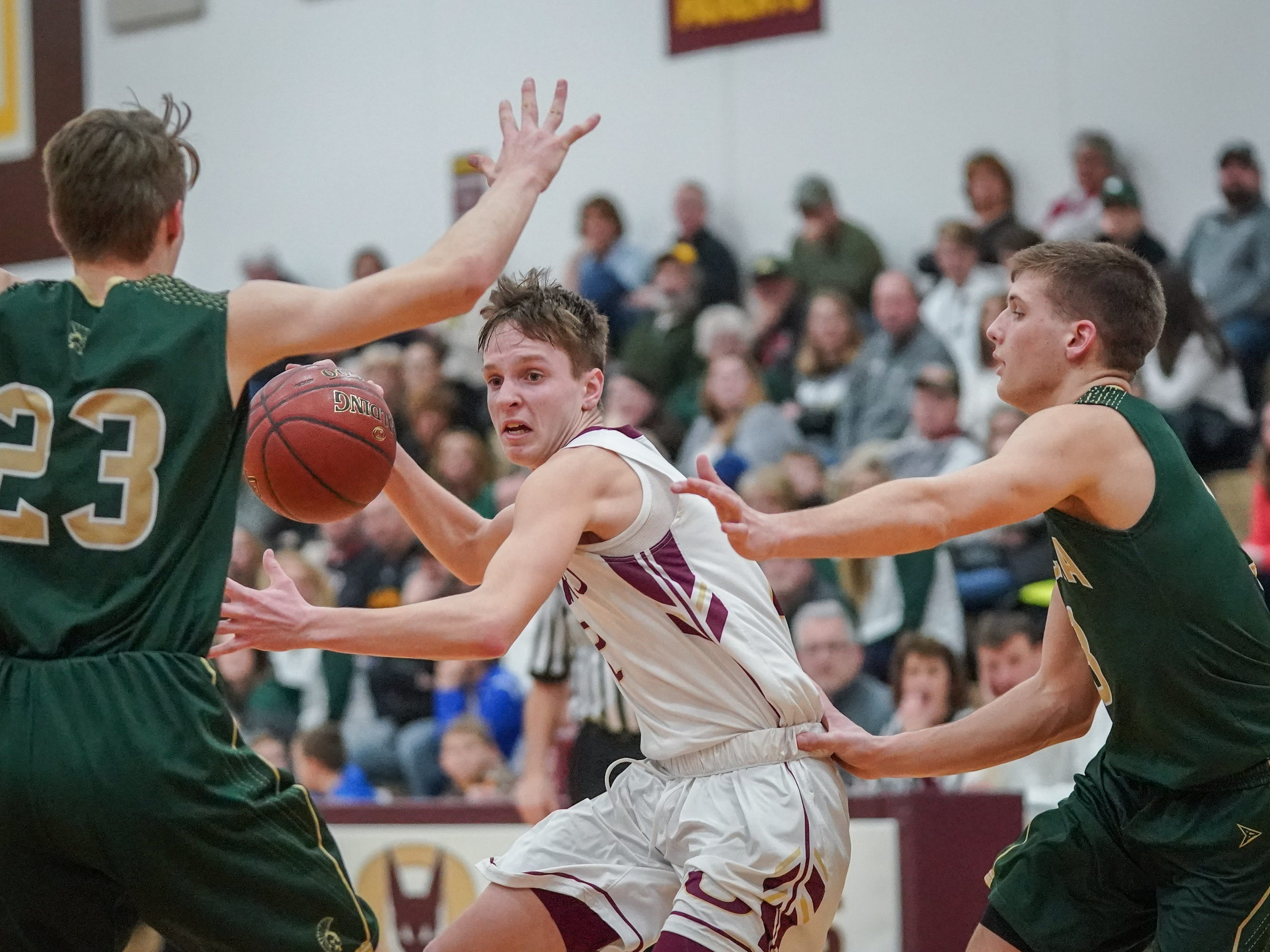 Carter Huth (2) of Omro fights his way to the basket. The Omro Foxes hosted the Laconia Spartans in a Flyway Conference basketball game Friday evening, January 11, 2019.