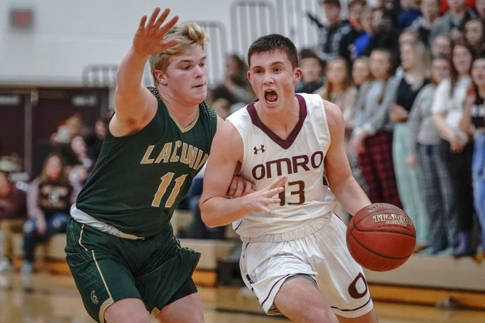 Evan Gitter (13) of Omro drives around Eli Leonard (11) of Laconia. The Omro Foxes hosted the Laconia Spartans in a Flyway Conference basketball game Friday evening, January 11, 2019.
