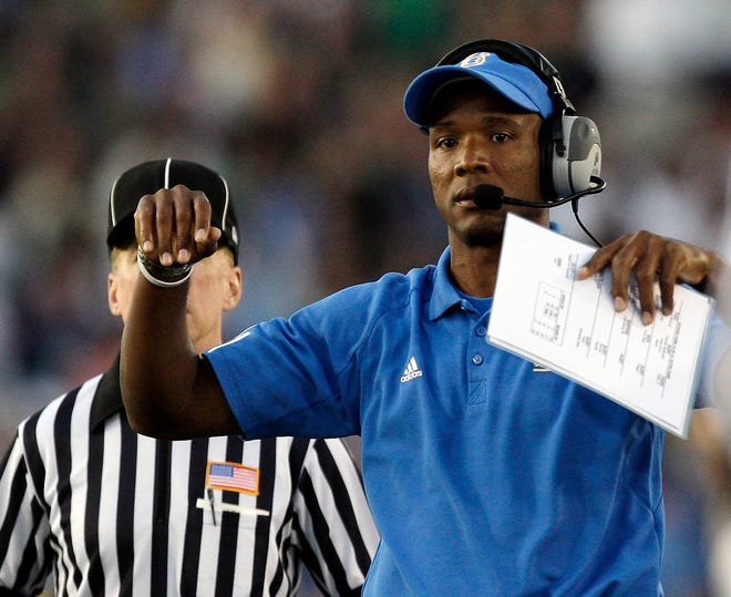 In this file photo, then-UCLA coach Karl Dorrell reacts to a penalty call during a game against Notre Dame at the Rose Bowl, in Pasadena, Calif., on Oct. 6, 2007.