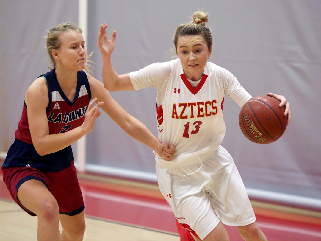 Palm Desert's Alexis Legan, right, drives to the basket against La Quinta's Francine Ansley during the game in Palm Desert on Friday, January 11, 2019. Palm Desert won.